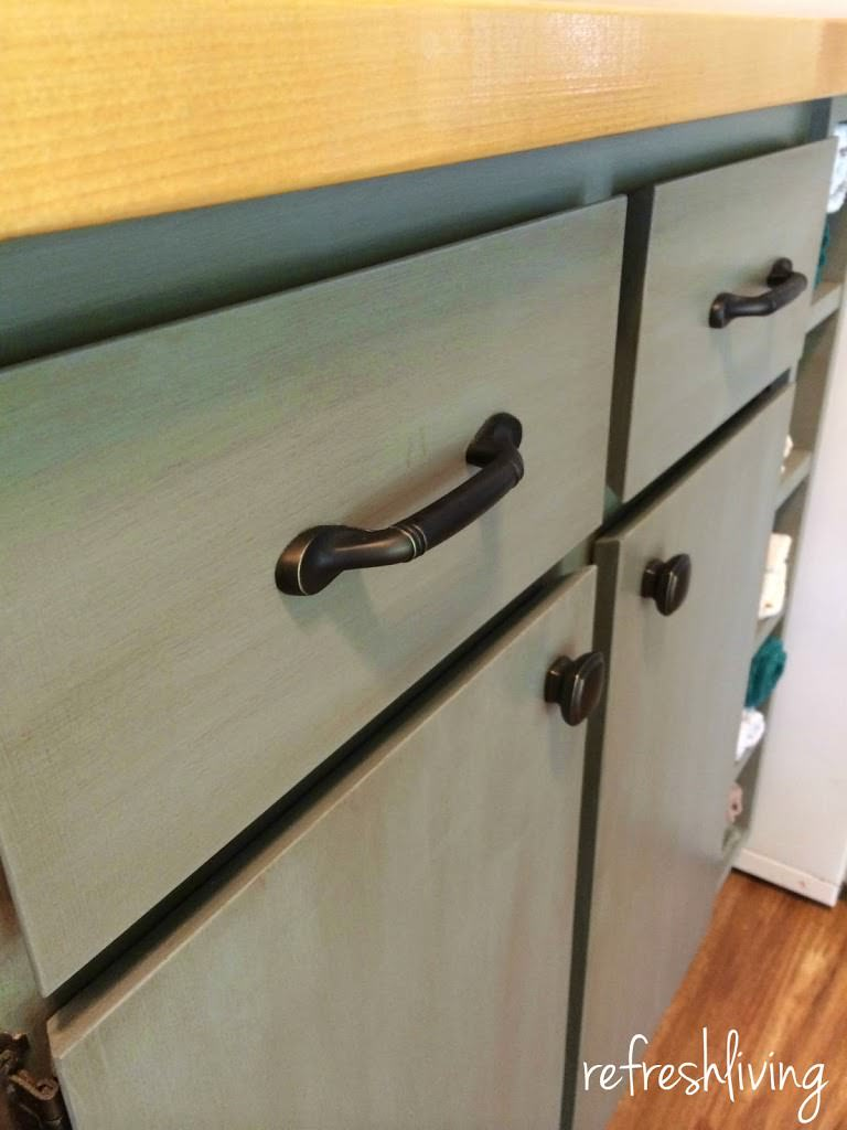 gray blue painted cabinets with butcher block counter