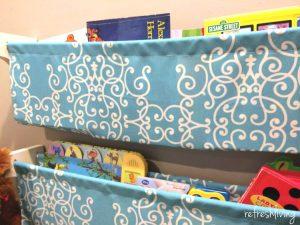 DIY bookshelves using dowel rods and fabric.