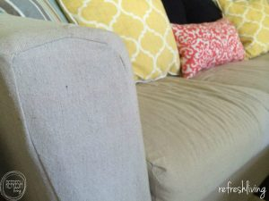 Using a drop cloth to recover a couch or sofa with a slipcover will save you hundreds of dollars! Plus, it's durable enough to hold up to daily use.