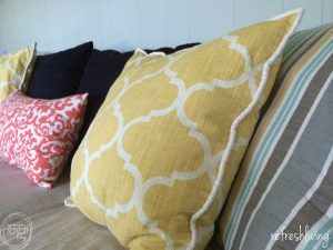 Change the look of your room by making slipcovers for your sofa. Sewing a custom slipcover for your couch is way easier than you might think. Using drop cloth material is a great way to make it a cheap project.