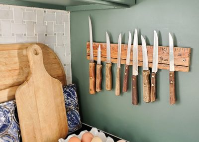 This magnetic knife holder looks easy enough to make with only a drill!