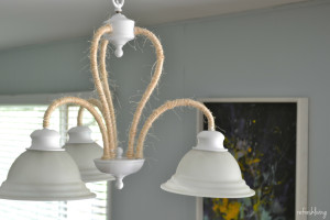 It's so easy to update an old light fixture with some paint and rope. By wrapping the twine around the light, it gives it a beachy, farmhouse feel. Easy, inexpensive update to completely change the look of a light fixture!