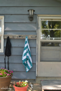 Use old wood to create a swimsuit and towel drying rack | School house vintage coat hooks on salvaged wood