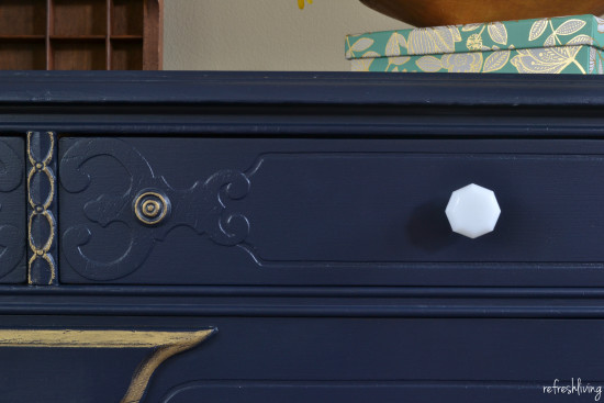 navy blue dresser with white knobs