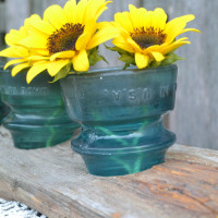 DIY Centerpiece with Glass Insulators and Dock Wood