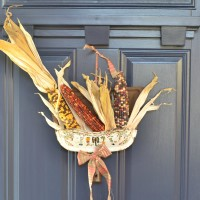 Unique fall wreath created with natural elements and vintage finds   Dustpan wreath   Upcycled dustpan as a front door hanging