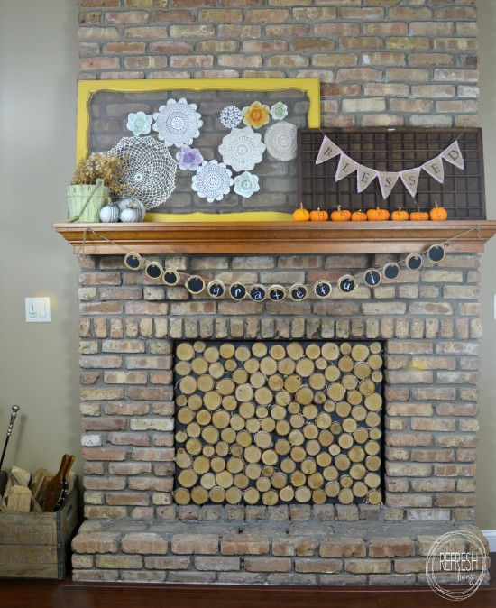 brick fireplace with fall mantel