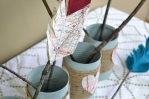 Rustic Valentine's Decor using leftover items from your home and yard   Upcycled tin can project   DIY felt arrows   valentine's centerpiece