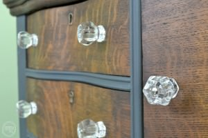 Antique glass knobs | Dark gray and stained oak dresser | Antique oak dresser with serpentine drawers with a stained wood top | Two toned dresser