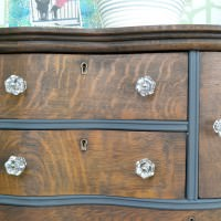 Dark gray and stained oak dresser | Antique oak dresser with serpentine drawers with a stained wood top