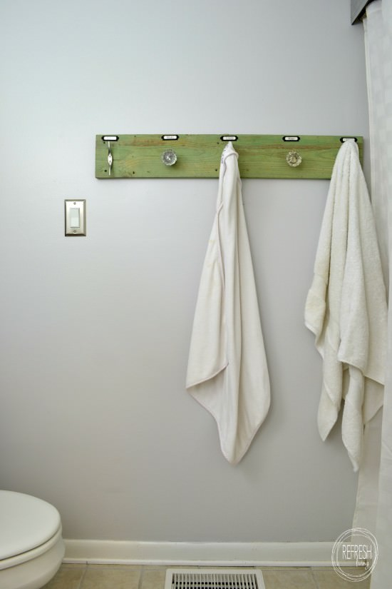 towel rack with antique glass doorknobs