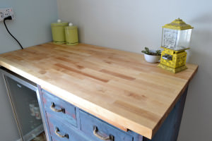 butcher block countertop | Reuse an old dresser as a countertop base | Antique Baker's Cabinet Upcycle | How to paint different colored layers of paint on furniture