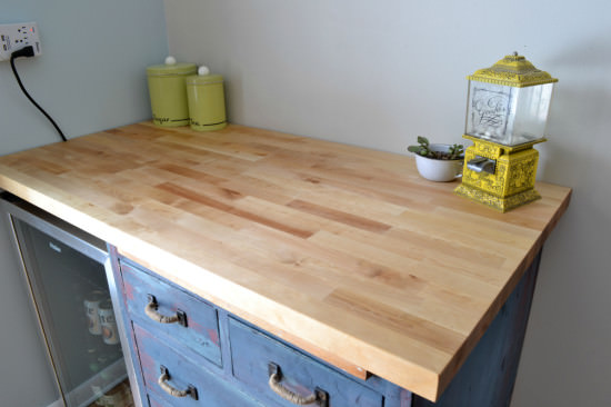 butcher block countertop with antique cabinet base