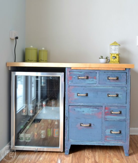 custom counter with beverage fridge and antique cabinet