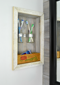Control bathroom countertop clutter by building a storage shelf in your wall, between the studs   how to build a shelf in your wall   store toothbrushes above the counter