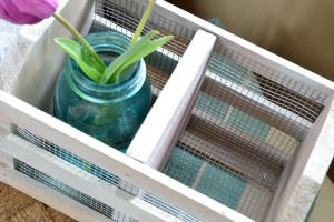 A crate from a thrift store can easily be made into a beautiful farmhouse crate with some chicken wire and a whitewash finish.