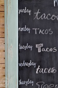 Create a chalkboard weekly menu board from an old cabinet door | Upcycled cabinet door becomes days of the week chalkboard | cheap and easy DIY menu board
