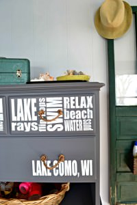 What can you do with a dresser without drawers? What a great idea to create a refinished dresser without drawers into storage for beach supplies! This would be great at a lake house or beach house. The subway lettering is a perfect way to customize it.