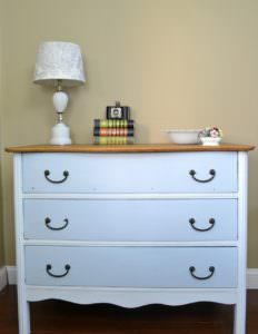 Antique dresser painted with white and turquoise with a natural wood top