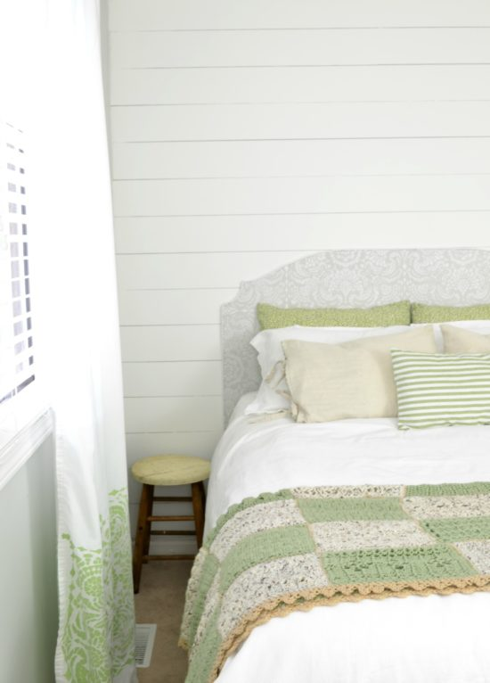 farmhouse bedroom with white and green
