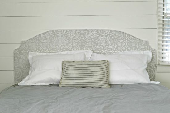 What an easy and inexpensive way to make a headboard! With so many different stencil designs, there are so many options to change up the design.