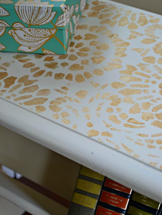 off white table with gold stencil