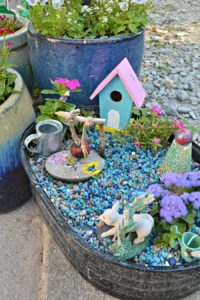 It's easy to create a DIY fairy garden with items you already have - and the kids can help!