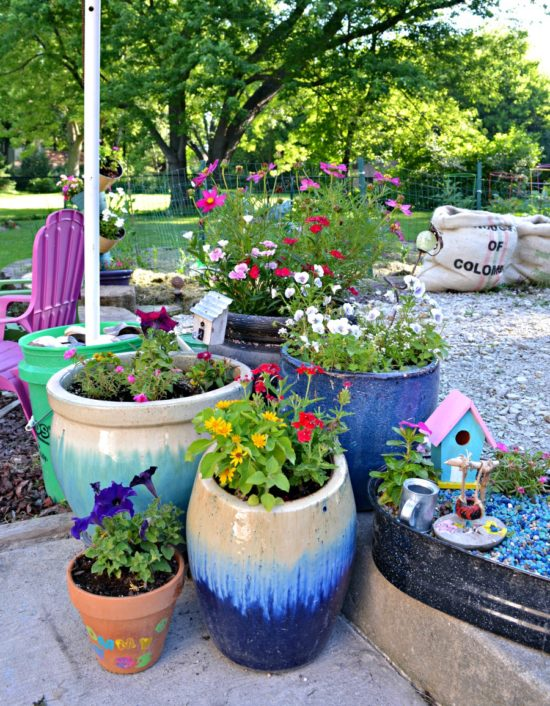 summer back yard tour stacked flower pots and fairy garden