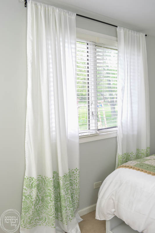 Who knew how easy it would be to make cheap curtains from plain flat sheets? Using a stencil for these DIY curtains lets you completely pick the design with colors and patterns!