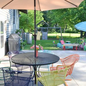 I love the multi-colored chairs! It's amazing how an old metal patio set can look new again with a coat of paint. This post also gives hints on how to cover up those rust spots!