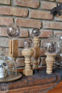 These Halloween crystal balls are so cool! I love the vintage Halloween images and the fact that they are made with dollar store ornaments and old spindles or candlesticks.