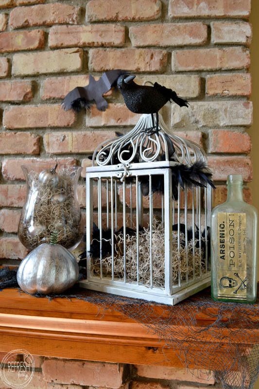 i love this spooky halloween mantel with vintage thrift store finds and printable images diy - Spooky Halloween Store