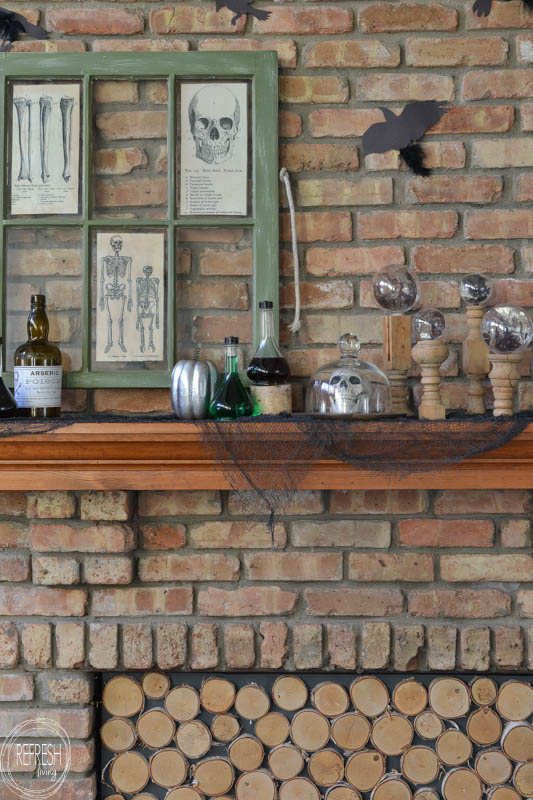 Create a spooky vintage Halloween mantel with thrift and dollar store finds and DIY projects. It's cheap and easy to create a vintage Halloween look without spending a lot of money!