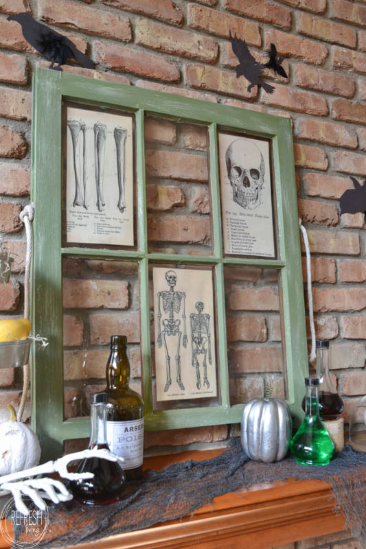 I love the use of an old window to display vintage graphics!  This Halloween mantel is made with tons of thrift store and dollar store finds, along with some easy DIY projects.