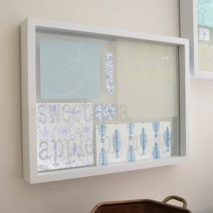 What a great way to use up that old scrapbook paper! By adding it to a floating picture frame, it acts as instant artwork. Glass etching cream can be used on the top piece of glass to custom with song lyrics or quotes.