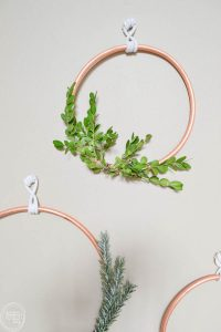 This would be such an easy DIY Christmas wreath!I love the contrast between the copper and greenery of the boxwood and evergreen. I bet eucalyptus would look great too!