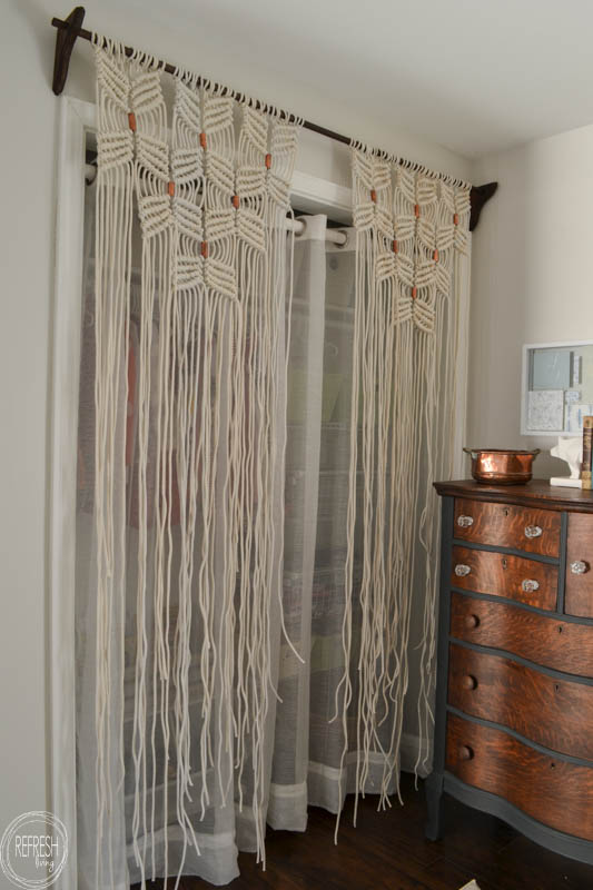 What a neat way to cover a closet opening without a door. I love the copper pipe to break up the pattern.