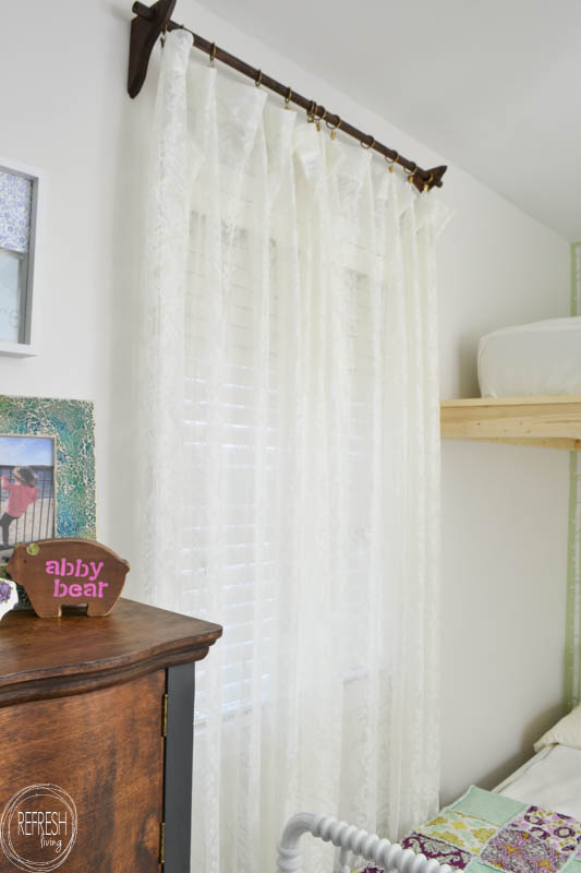 This shared bedroom for two little girls is not only adorable, but also functional! The best part might be how many DIY projects there are that you can create on your own, without spending a ton of money.