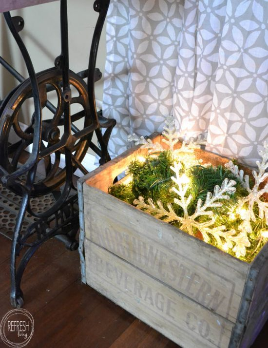 Fill an old crate with a strand of garland and lights