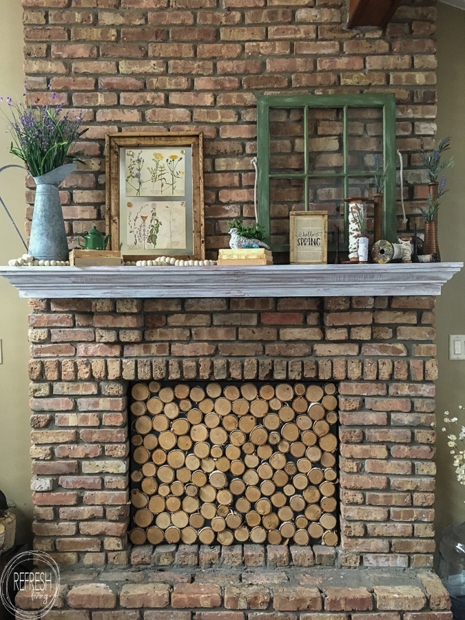 The vintage items used in this farmhouse inspired Spring mantel are perfect!