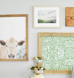 This farmhouse gallery wall has the perfect mix of neutral with a little bit of color. Since I can't have a cow of my own, I'm going to hang one on my wall!