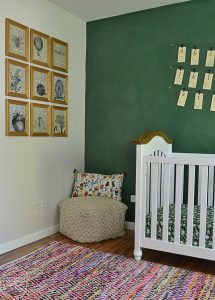 This green chalkboard wall is the perfect touch in this vintage schoolhouse nursery.