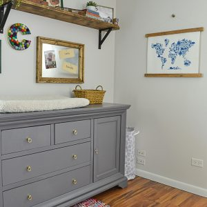 This nursery dresser was updated with a coat of gray paint and new brass pulls.