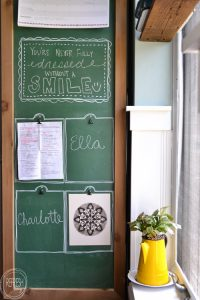 Genius! Use the side of the fridge as a command center by painting it with chalkboard paint and making an easy DIY frame. The way the wood is attached to the side is definitely a smart idea!