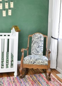 An old vintage rocking chair gets a new look with stripped wood and a modern black and white fabric.