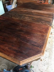 Tips and tricks for stripping wood furniture. This vintage dining table only cost $37, but with some time and effort, it has been turned into a beautiful piece of furniture.