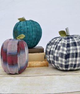 Adding old flannel shirts to pumpkins is a great way to reuse what you already have to create farmhouse decorations for fall.