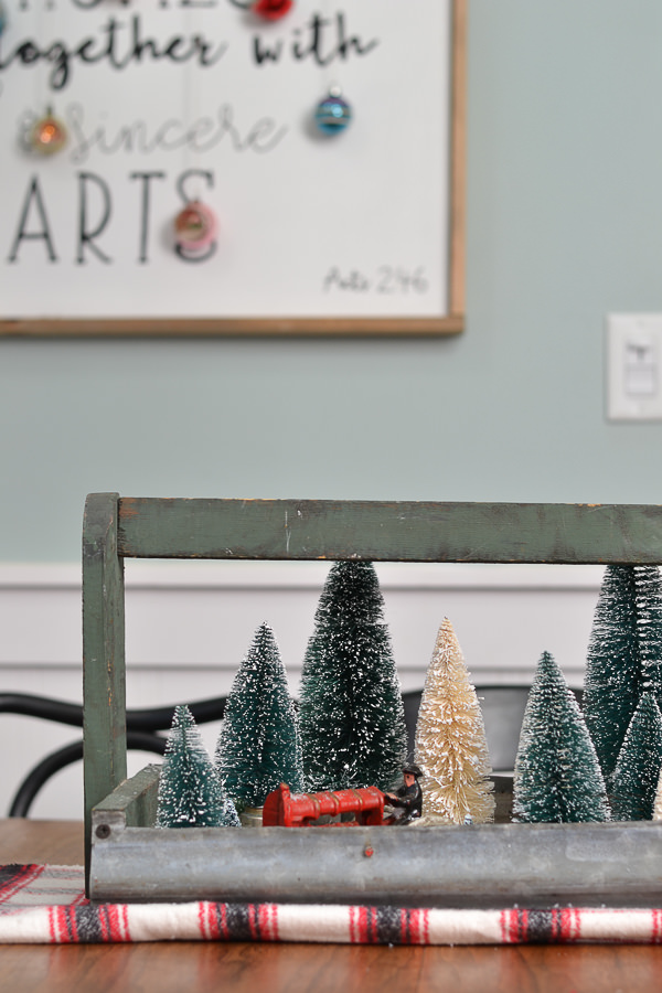 I love the way vintage elements were brought into this dining room in a modern way for Christmas.