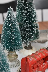 I will be putting my bottle brush trees in vintage doorknobs forever now!