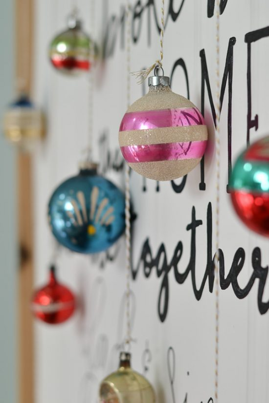 I love the idea to hang ornaments from a sign or piece of art.